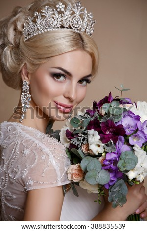 Beautiful Bride portrait wedding makeup and hairstyle with diamond crown, fashion bride model jewelry and beauty girl face, gorgeous beauty bride,bride in luxury wedding dress, isolated studio series - stock photo