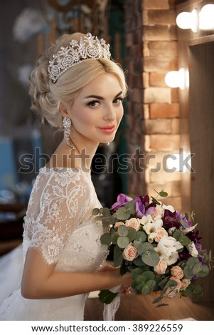 Beautiful Bride portrait wedding makeup and hairstyle with diamond crown, fashion bride model jewelry and beauty girl face, gorgeous beauty bride, soft grain filter instagram like - stock photo