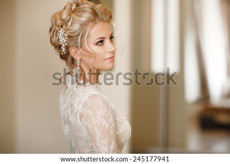 Beautiful Bride Portrait wedding makeup, wedding hairstyle, Wedding dress. Wedding decoration. soft selective focus. gorgeous young bride at home. series.  - stock photo