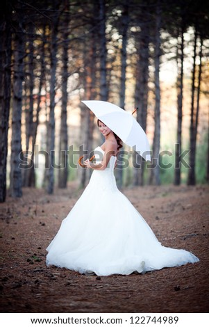 beautiful bride portrait with red umbrella - stock photo