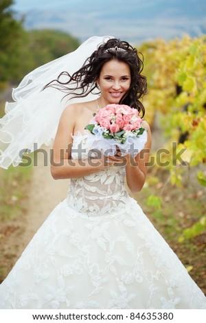Beautiful bride posing in her wedding day - stock photo
