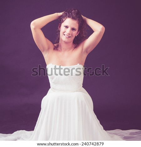 beautiful bride posing in studio - stock photo
