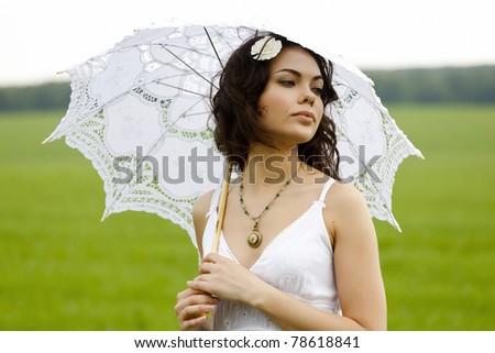 Beautiful bride posing outdoors - stock photo