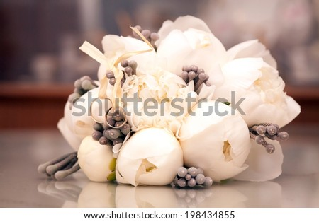 Beautiful bride's bouquet and wedding rings - stock photo