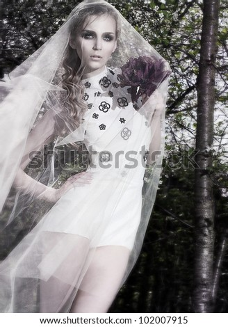 Beautiful bride serene woman posing in the forest outdoor tree park - stock photo