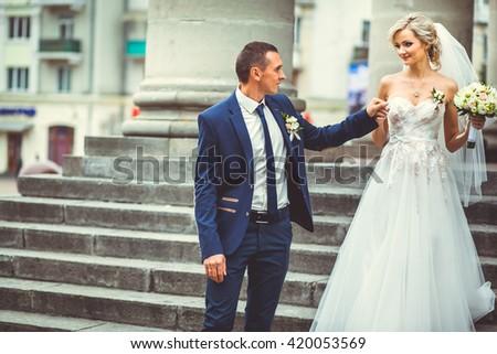 Beautiful bride walking city - stock photo