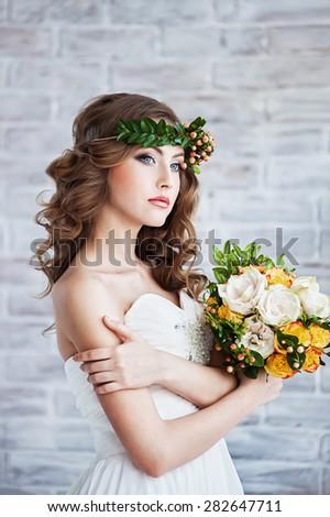 Beautiful bride wearing a wreath - stock photo