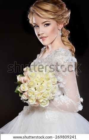 Beautiful bride. Wedding hairstyle and make up - stock photo