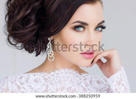 Beautiful bride. Wedding hairstyle and make up. - stock photo