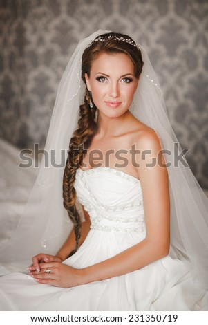 Beautiful bride wedding makeup and hairstyle. Young happy girl at marriage day. portrait of young woman. soft tonality.