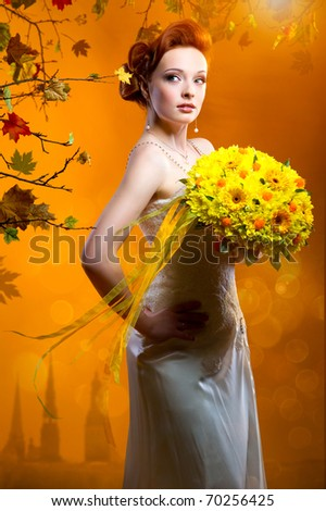 Beautiful bride with a bouquet of flowers - stock photo