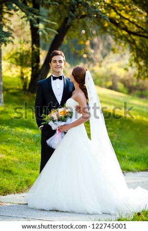 beautiful bride with a handsome groom happy together - stock photo