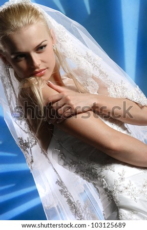 beautiful bride with an apple on a yellow background - stock photo