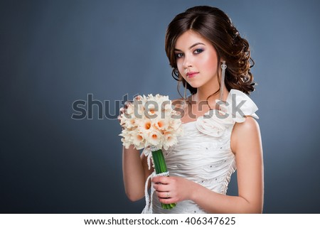 Beautiful bride with bouquet of flowers. Wedding style. - stock photo