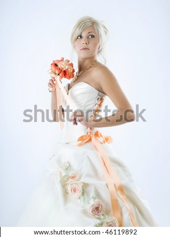 beautiful bride with bouquet on white background studio shot - stock photo