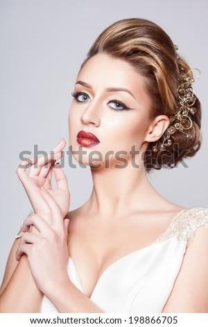 Beautiful bride with fashion hairstyle and make-up