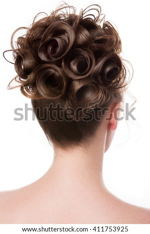 Beautiful bride with fashion wedding hairstyle - on white background - stock photo