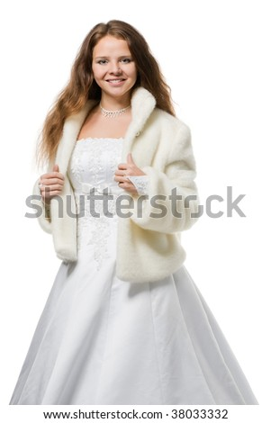 beautiful bride with long hair in a wedding dress fur coat looks in the camera, isolated on white