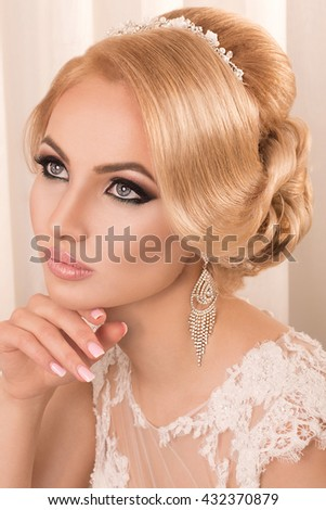 Beautiful bride with makeup and hairstyle.