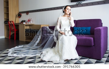beautiful bride  with mobile phone. Concept of love and  interest. Newlywed