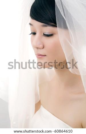 Beautiful bride with perfect natural makeup,wearing mantilla - stock photo