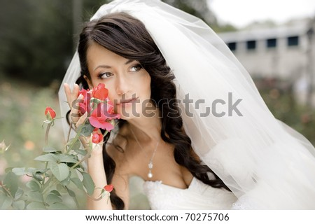 beautiful bride with rose - stock photo