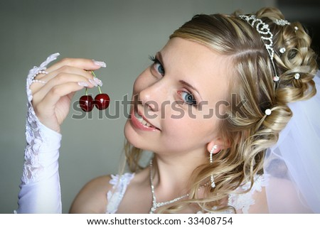 Beautiful bride with sweet berry - stock photo