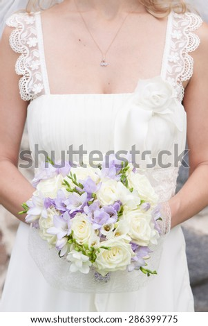 Beautiful brides wedding flowers and wedding dress.