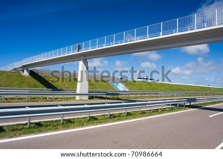 Beautiful bridge on the blue background - stock photo