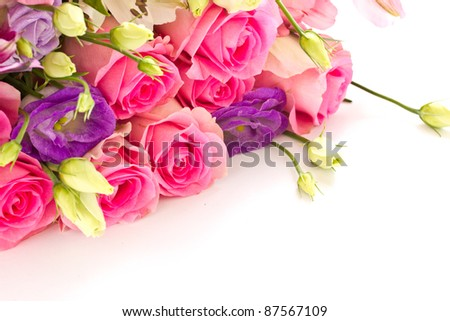 beautiful bright bouquet of roses, Lisianthus and other flowers on a white background - stock photo