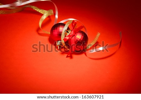beautiful bright Christmas balls on red background - stock photo
