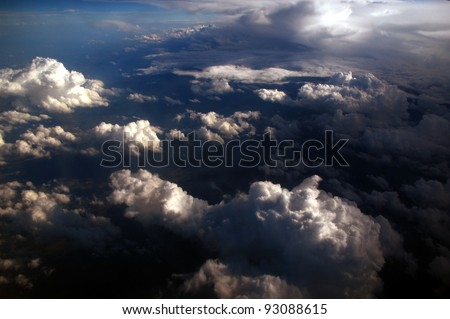 beautiful bright clouds, view from above, in the right is the shadow of a big cloud. - stock photo