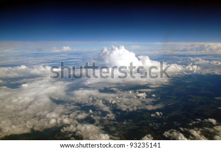 Beautiful bright clouds, view from above. Over European continent.