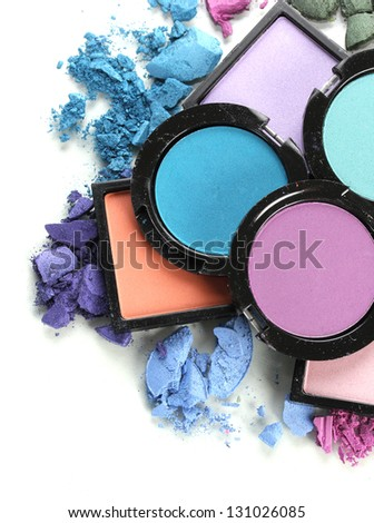 Beautiful bright eye shadows isolated on white - stock photo