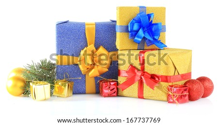 Beautiful bright gifts and christmas decor, isolated on white - stock photo