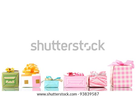 Beautiful bright gifts isolated on white - stock photo