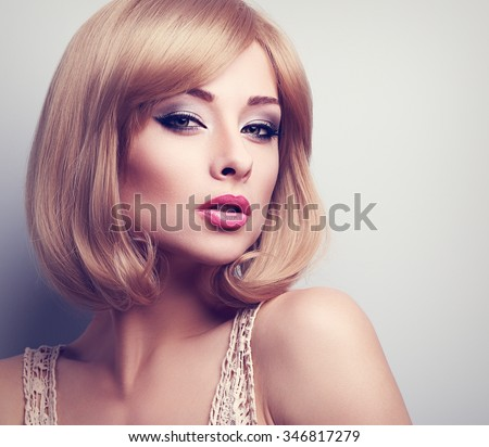 Beautiful bright makeup blond woman with short hair style looking sexy. Closeup portrait - stock photo