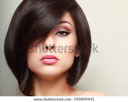 Beautiful bright makeup woman with black short hair style. Closeup - stock photo