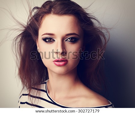 Beautiful bright makeup woman with pink lipstick and wind hair. Closeup vintage portrait - stock photo