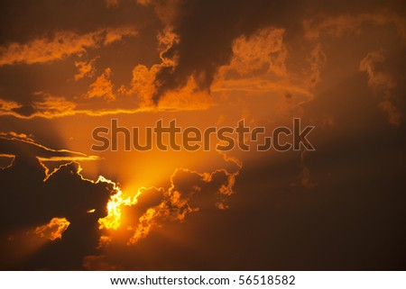 Beautiful bright orange sunset in the clouds - stock photo