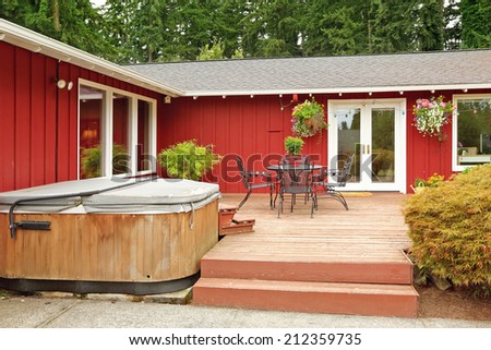 Beautiful bright red house with patio area and walkout deck