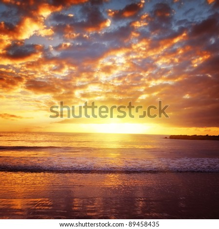 Beautiful bright sunset on the ocean. - stock photo