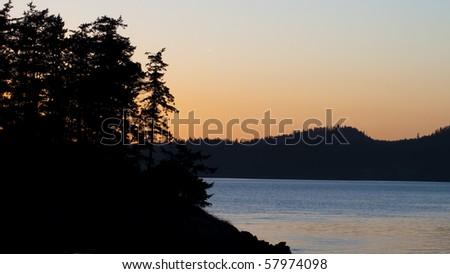 Beautiful bright sunset over Puget Sound in Western Washington. - stock photo