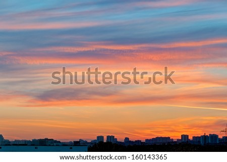 Beautiful bright sunset with cloudscape and multicolored evening glowing over skyline. Moscow, Russia.  - stock photo
