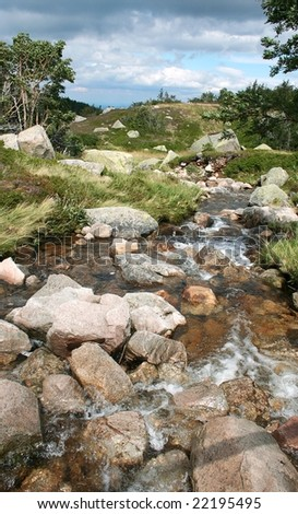 Beautiful brook with sky and clouds - stock photo