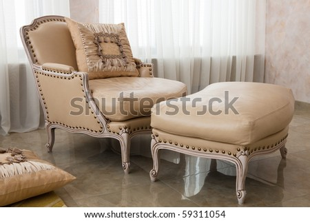 beautiful brown armchair in a modern apartment - stock photo