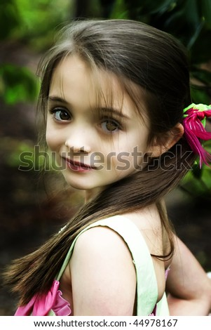Beautiful brown-eyed brunette girl with a ponytail. - stock photo