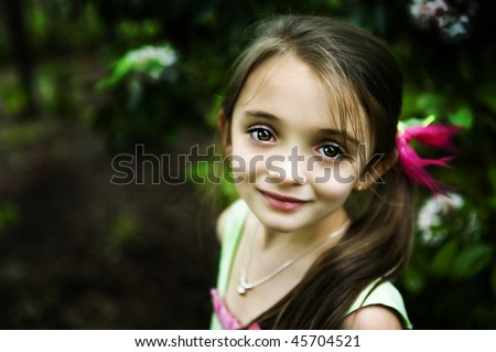 Beautiful brown-eyed brunette little girl with a sweet smile - stock photo