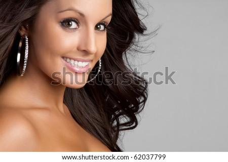 Beautiful brown eyes smiling woman - stock photo
