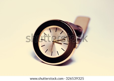 beautiful brown ladies watch with an unusual abstract design on a white background